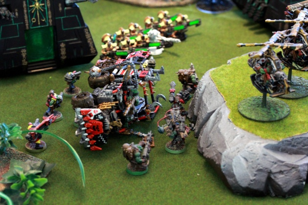 Monoliths, Immortals and Destroyers combined their shootings to wreck the Trukk and kill two of the Deffkoptas hovering about on top of the hill. Burna Boyz do a nice dispersed disembarking to avoid the Particle Whip's large blast template as much as possible.
