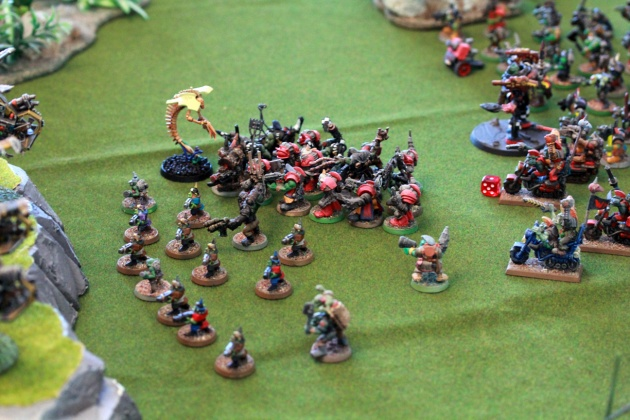 Wow! The single remaining Wratih hopped on, soaked the overwatch fire from the Battlewagon's passengers, charged it and exploded the crap out of it! Shrapnels extended to 6 inches killing a number of innocent nearby Gretchins, some passengers and even managed to wound an Ork biker.