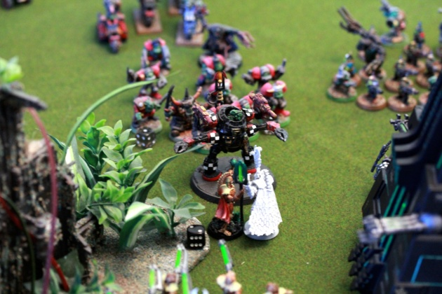 Orks annihilate the whole lot of Lychguards and their super-duper characters ... just to experience their resurrection. These dudes popped-up, assaulted the DeffDread and killed it.