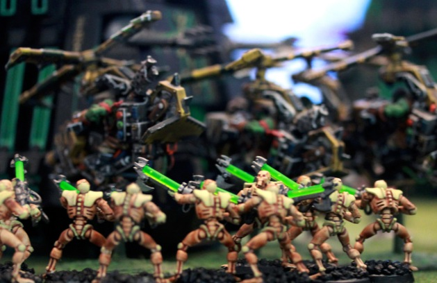 Warriors disembark right behind the DeffKoptas that are scraping metal off of the Monolith. Shooting commences shortly after.