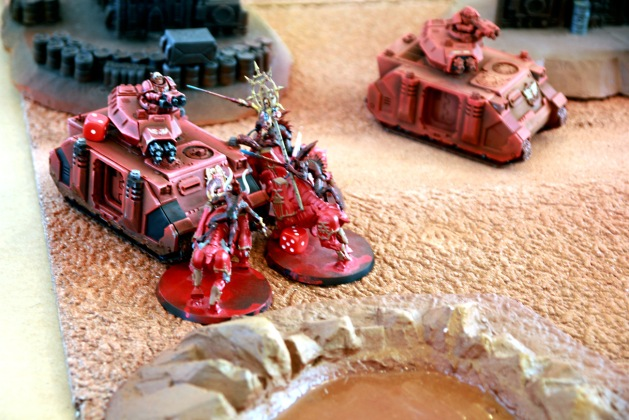 Bloodcrushers inflicting two hull damage on Baal Predator rendering it immobilized.